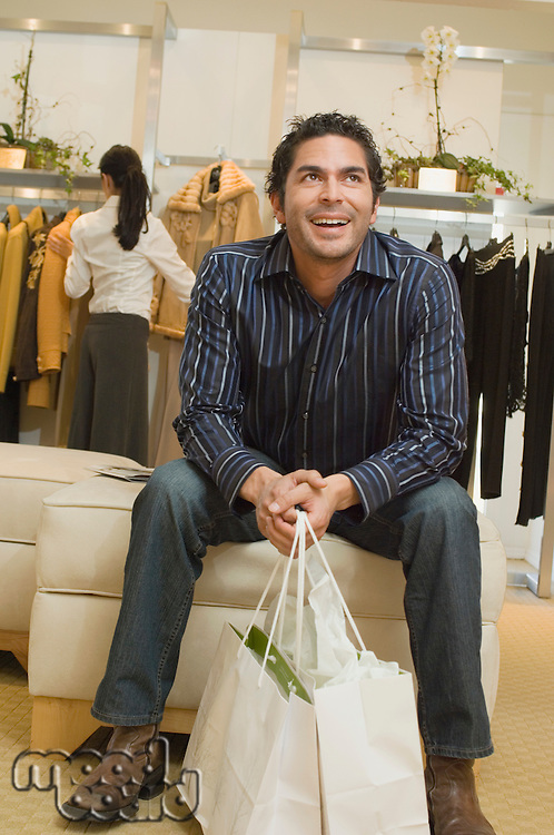 Man Waiting in Boutique
