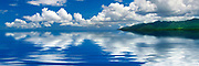 Drifting clouds reflecting on a tranquil sea in Hawaii. Signed and numbered Limited Edition of 250 canvas giclees.