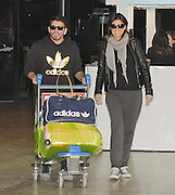 01.NOVEMBER.2012. BUENOS AIRES <br /> <br /> DIEGO MARADONA JR AND GIRLFRIEND YESICA DI VICENSO ARRIVE BACK IN BUENOS AIRES. THE SON OF MARADONA WILL HELP HIS FATHER TO SOLVE SOME LEGAL AND ECONOMIC ISSUES. DIEGO JR. MUST BE PRESENT AT THE CIVIL COURT OF BUENOS AIRES, AND WILL ALSO ATTEND A TV PROGRAM.<br /> <br /> BYLINE: EDBIMAGEARCHIVE.CO.UK<br /> <br /> *THIS IMAGE IS STRICTLY FOR UK NEWSPAPERS AND MAGAZINES ONLY*<br /> *FOR WORLD WIDE SALES AND WEB USE PLEASE CONTACT EDBIMAGEARCHIVE - 0208 954 5968*