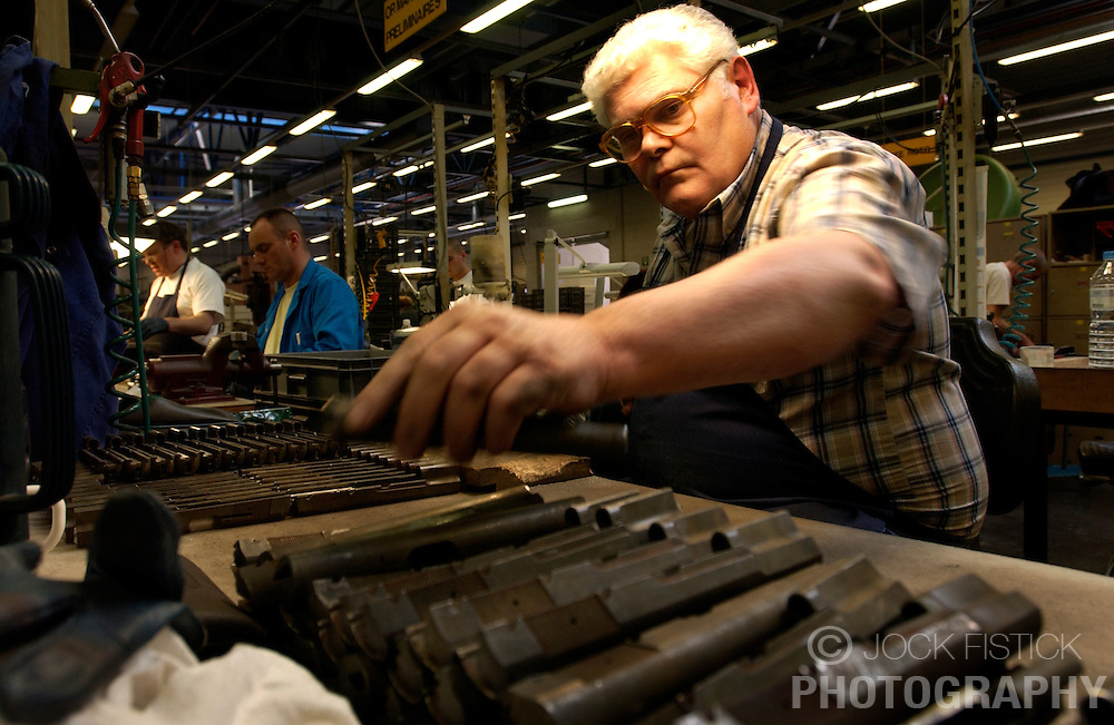 HERSTAL, BELGIUM - APRIL-11-2003 - Technicians work on manufacturing the many small parts of firearms at the FN Herstal weapons fabrication plant near Liege, Belgium. (PHOTO © JOCK FISTICK)