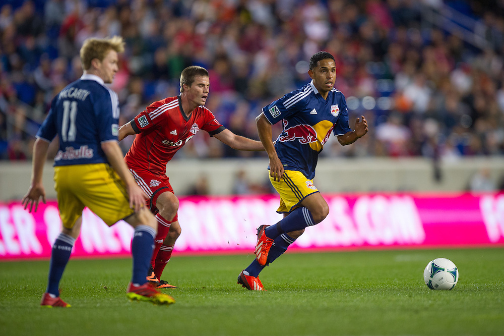 HARRISON, NJ - SEPTEMBER 14:  Michael Bustamante #23 of New York Red Bulls dribbles the ball during the game against the Toronto FC at Red Bulls Arena on September 14, 2013. (Photo By: Rob Tringali)