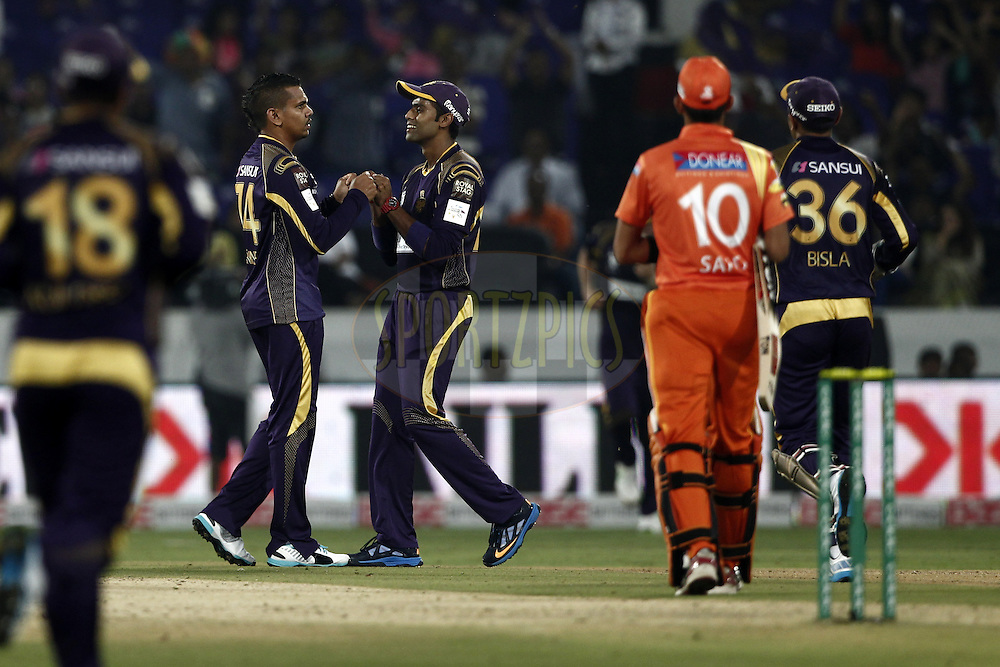 Sunil Narine , Yadav of the Kolkata Knight Riders  celebrates the wicket of  Saad Naseem of the LAHORE LIONS during match 7 of the Oppo Champions League Twenty20 between the Kolkata Knight Riders and the Lahore Lions held at the Rajiv Gandhi Cricket Stadium, Hyderabad, India on the 21st September 2014<br /> <br /> Photo by:  Deepak Malik / Sportzpics/ CLT20<br /> <br /> <br /> Image use is subject to the terms and conditions as laid out by the BCCI/ CLT20.  The terms and conditions can be downloaded here:<br /> <br /> http://sportzpics.photoshelter.com/gallery/CLT20-Image-Terms-and-Conditions-2014/G0000IfNJn535VPU/C0000QhhKadWcjYs