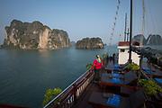 Andrea Johnson enjoying view of  Bai Tu Long Bay from Dragon Pearl boat, northern Vietnam
