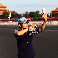 BEIJING, SEPT.2, 2015 : local Beijingers visit Tiananmen square a last time early in the morning before it gets sealed off for the celebrations to commemorate the 70th anniversary of the end of World War II.