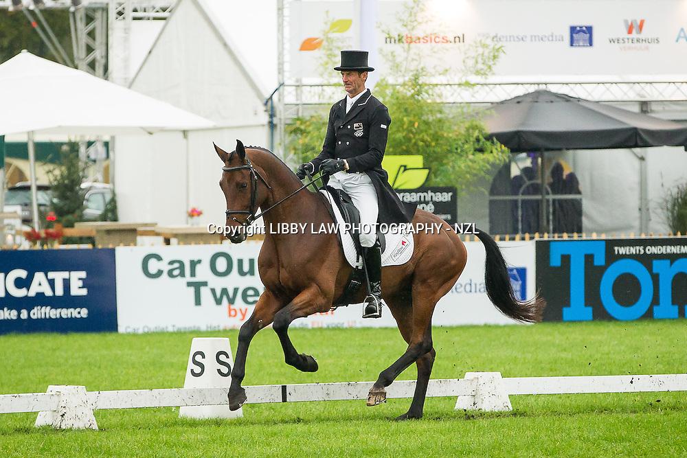NZL-Sir Mark Todd (LEONIDAS II) INTERIM-15TH: CCIO3* DRESSAGE: 2013 NED-Military Boekelo International Horse Trial (Friday 11 October) CREDIT: Libby Law: COPYRIGHT: LIBBY LAW PHOTOGRAPHY - NZL
