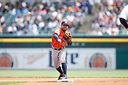 DETROIT, MI - MAY 21: Jose Altuve #27 of the Houston Astros turns a double play during the game against the Detroit Tigers at Comerica Park on May 21, 2015 in Detroit, Michigan. The Tigers defeated the Astros 6-5 in 11 innings. (Photo by Joe Robbins) *** Local Caption *** Jose Altuve