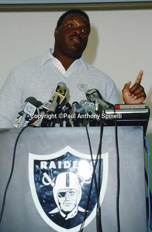 Oakland Raiders head coach Art Shell speaks at the podium after being announced as the newest coaching hire in a NFL press conference on Oct. 3, 1989 in Oakland, Calif. (©Paul Anthony Spinelli)