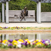 The statue, with flowers in the foreground, at the George Mason Memorial in Washington DC in Potomac Park near the Jefferson Memorial. The memorial honors one of the lesser known Founding Fathers.