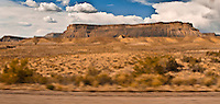 Interstate 70, US 6, US 50, and US 191 rushes past Hatch Mesa east of Green River, Utah panorama