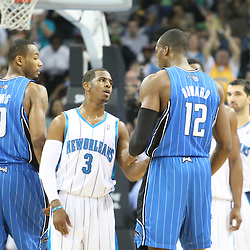 18 February 2009: New Orleans Hornets guard Chris Paul (3) and Orlando Magic center Dwight Howard (12) talk during a break in the action of a NBA basketball game between the Orlando Magic and the New Orleans Hornets at the New Orleans Arena in New Orleans, Louisiana.