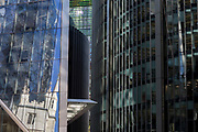 The reflections of the Swiss re tower (aka The Gherkin) and the church of St. Mary Axe in the City of London, the capital's historic financial district, on 2nd August 2018, in London, England.