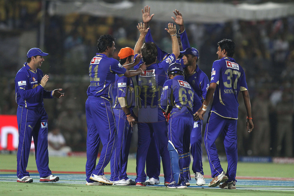 Rajasthan Royals celebrate Chris Gayle of the Royal Challengers Bangalore wicket during match 30 of the the Indian Premier League (IPL) 2012  between The Rajasthan Royals and the Royal Challengers Bangalore held at the Sawai Mansingh Stadium in Jaipur on the 23rd April 2012..Photo by Shaun Roy/IPL/SPORTZPICS