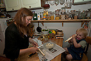 Astrid Holmann of the Hollmann Sturm family in Hamburg, Germany with her daughter Lillith Sturm. Preparing white asparagus. They were photographed for the Hungry Planet: What I Eat project with a week's worth of food in June. Model Released.