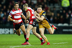 Charlie Sharples of Gloucester Rugby is tackled by Jason Woodward of Bristol Rugby - Rogan Thomson/JMP - 03/12/2016 - RUGBY UNION - Kingsholm Stadium - Gloucester, England - Gloucester Rugby v Bristol Rugby - Aviva Premiership.