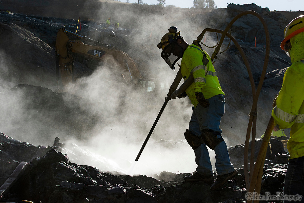 Rocks are cleaned by water and a compressed air in preparation for concrete placement on the lower chute of the Lake Oroville flood control spillway in Butte County, California. Photo taken July 12, 2017. <br /> Brian Baer/ California Department of Water Resources<br /> FOR EDITORIAL USE ONLY