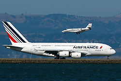 Cessna 680 Citation Sovereign (N387QS) operated by NetJets lands past Airbus A380-861 (F-HPJG) operated by Air France to San Francisco International Airport (KSFO), San Francisco, California, United States of America
