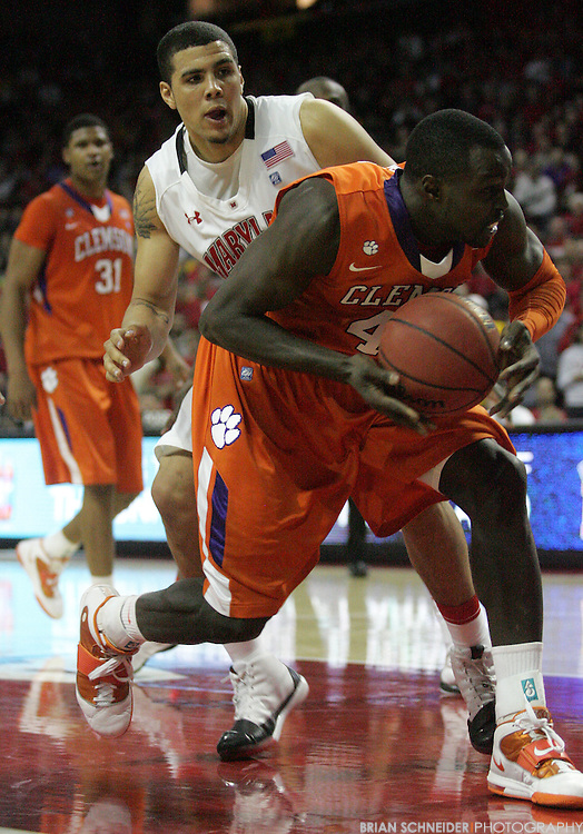 Jan 22, 2011; College Park, MD, USA; Clemson Tigers forward Jerai Grant (45) and Maryland Terrapins forward Jordan Williams (20) go for a loose ball during the second half at the Comcast Center. Mandatory Credit: Brian Schneider-www.ebrianschneider.com