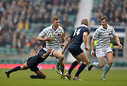 Twickenham. UK.   Cambridge's, Toby MAY, running through with the ball during the  the 2013 Varsity Rugby Match,  Final score Oxford, defeating Cambridge,  33 - 15 on    Thursday  12/12/2013, at the RFU Stadium.  Surrey, England  [Mandatory Credit. Peter Spurrier/Intersport Images]