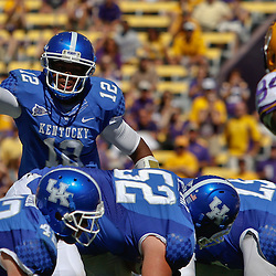 October 1, 2011; Baton Rouge, LA, USA;  Kentucky Wildcats quarterback Morgan Newton (12) against the LSU Tigers during the fourth quarter at Tiger Stadium. LSU defeated Kentucky 35-7. Mandatory Credit: Derick E. Hingle-US PRESSWIRE / © Derick E. Hingle 2011