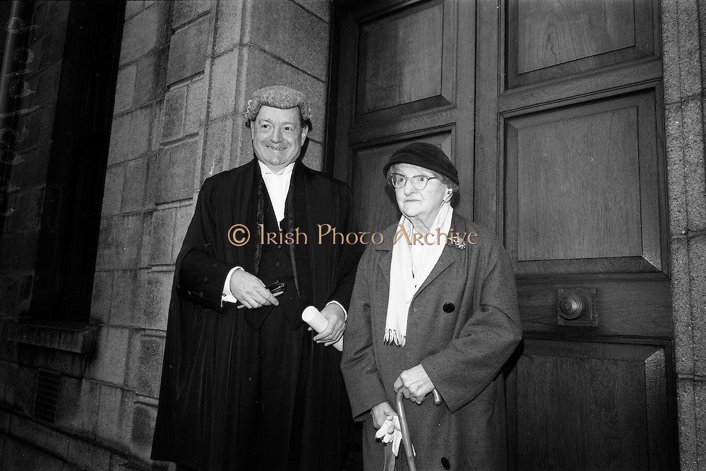 19/05/1966<br /> 05/19/1966<br /> 19 May 1966<br /> Mr Justice Herbert E. Wellwood appointed as new Judge of the Circuit Court. Picture shows Judge Wellwood with his mother, Mrs. Richard N. Wellwood after he was sworn in by Chief Justice Mr. Cearbhall Ó Dálaigh at the Supreme Court, Dublin.