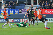 York City defender Keith Lowe puts the ball past Luton Town goalkeeper Mark Tyler to score York City opener  during the Sky Bet League 2 match between Luton Town and York City at Kenilworth Road, Luton, England on 10 October 2015. Photo by Simon Davies.