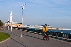 Male cyclist rides along the San Francisco Bay Trail, San Francisco, California, United States of America