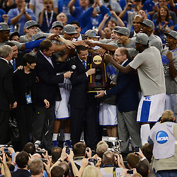 Apr 2, 2012; New Orleans, LA, USA; Kentucky Wildcats players rub the head of head coach John Calipari as he holds the NCAA National Championship trophy after defeating the Kansas Jayhawks 67-59 in the finals of the 2012 NCAA men's basketball Final Four at the Mercedes-Benz Superdome. Mandatory Credit: Derick E. Hingle-US PRESSWIRE
