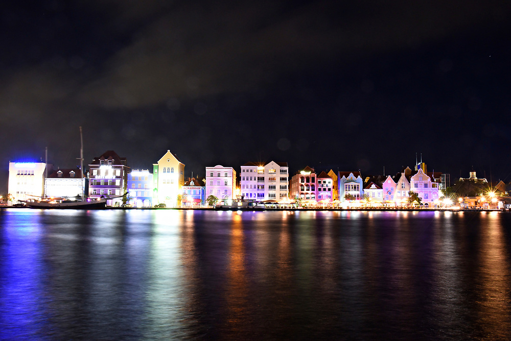 WILLEMSTAD, CURACAO - DECEMBER 11, 2014:  The instantly recognizable Curacao cityscape with its uniquely Dutch architecture facing Willemstad Harbor is seen lit up at night. (photo by Melissa Lyttle)
