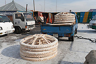 Mongolia. Ulaanbaatar. yurt area in Narantuul market, where you can find everything to build your own yurt, felt wood and any other good you need in a ger and in the steppe  Ulan Baatar /  secteur des yourtes dans le grand Marche de Narantuul, ou on peut trouver absolument tout ce qu'il faut pour construire et amenager une yourte, feutre, bois, poele etc.  Oulan Bator - Mongolie