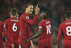 LIVERPOOL, ENGLAND - Friday, April 26, 2019: Liverpool's Sadio Mane celebrates scoring the fourth goal with team-mate Virgil van Dijk during the FA Premier League match between Liverpool FC and Huddersfield Town AFC at Anfield. (Pic by David Rawcliffe/Propaganda)