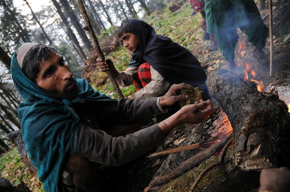 Trying to keep warm during a freezing Himalayan rain.