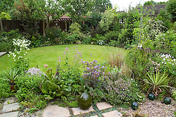 Circular lawn surround by border in early June