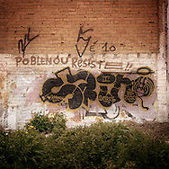 "Poble Nou, Barcelona..One of the mural paintings of Poble Nou the working class residential neighborhood of Barcelona. Poble Nou is the historical district of Catalunia built and developed in 1800 around textile factories. During the last 10 years the whole area has changed completely. In 2000 the Barcelona City Council approved a new urban program based on the creation of the new technological and innovation district. To realize the project, named  ""22@"", many historical factories, buildings and places have been razed to the ground to give way to skyscraper offices, university and research laboratories. The last  ten years  the residence of Pobe Nou start fighting against @22 project to defend their houses but also the history and memory of the district."