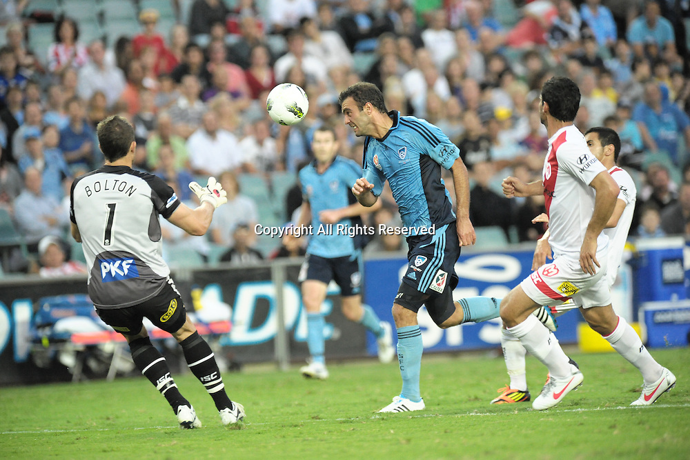 29.12.2011 Sydney, Australia.Sydney forward  Bruno Cazarine and Melbourne Heart goalkeeper Clint Bolton about to collide during the A-League game between Sydney FC and Melbourne Heart played at the Sydney Football Stadium.