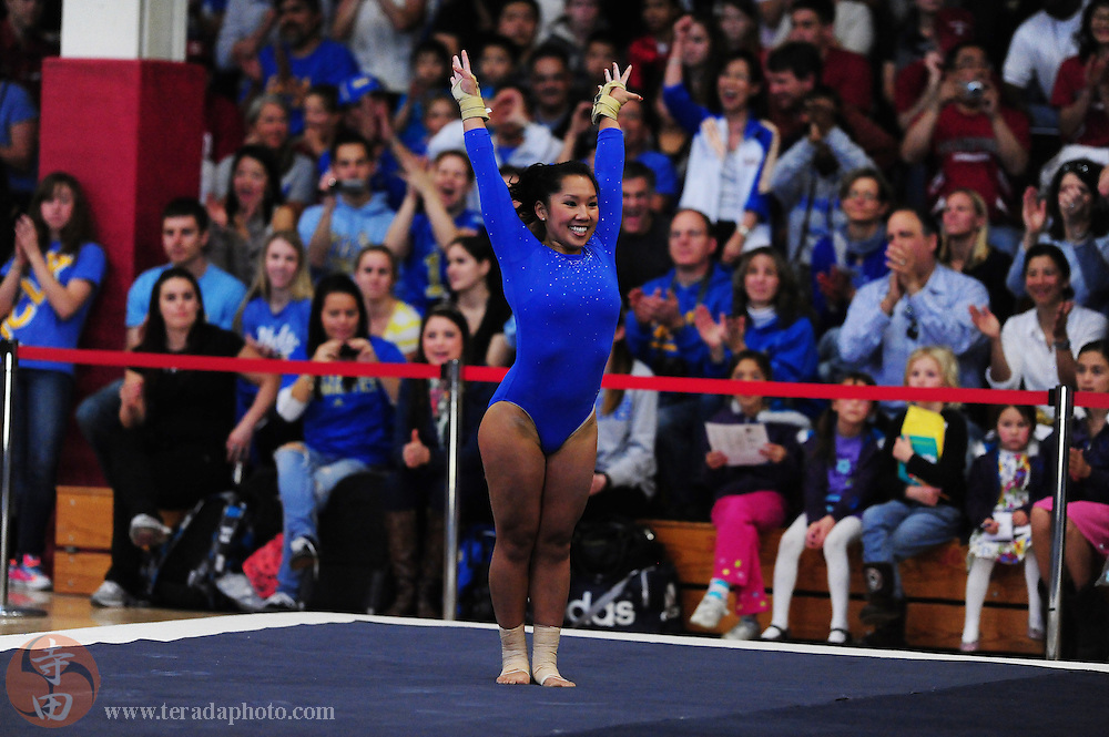 January 23, 2011; Stanford, CA, USA; UCLA Bruins gymnast Niki Tom performs on the floor during the meet against the Stanford Cardinal at Burnham Pavilion. The Cardinal defeated the Bruins 196.200-194.825. Mandatory Credit: Kyle Terada-Terada Photo
