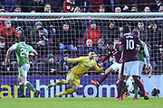 Don Cowie gets a touch on Christophe Berra's header to score goal during the William Hill Scottish Cup 4th round match between Heart of Midlothian and Hibernian at Tynecastle Stadium, Gorgie, Scotland on 21 January 2018. Photo by Kevin Murray.