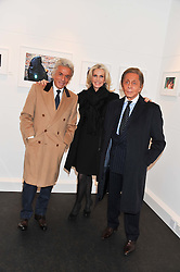 Left to right, GIANCARLO GIAMMETTI, CHARLENE de GANAY, designer VALENTINO GARAVANI at a private view of photographs by Anthony Souza held at The Little Black Gallery, 13A Park Walk, London SW10 on 13th December 2011.