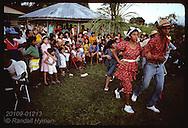 Teens dance traditional quadrilha at Festa Junina (June Fest) celebration on Carvalho ranch near Eirunepe, Brazil.