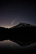 Mount Rainier and Comet C/2020 F3 (NEOWISE) are reflected on Reflection Lake in Mount Rainier National Park, Washington. Mount Rainier, which has a summit of 14,411 feet (4,392 meters), is the highest mountain in Washington state and largest volcano in the Cascade Range. Comet NEOWISE is a long-period comet and its current orbital path will take about 6,800 years to complete. Its nucleus is about 3 miles (5 kilometers) across and is covered with sooty, dark particles left over from its formation near the birth of our solar system 4.6 billion years ago.