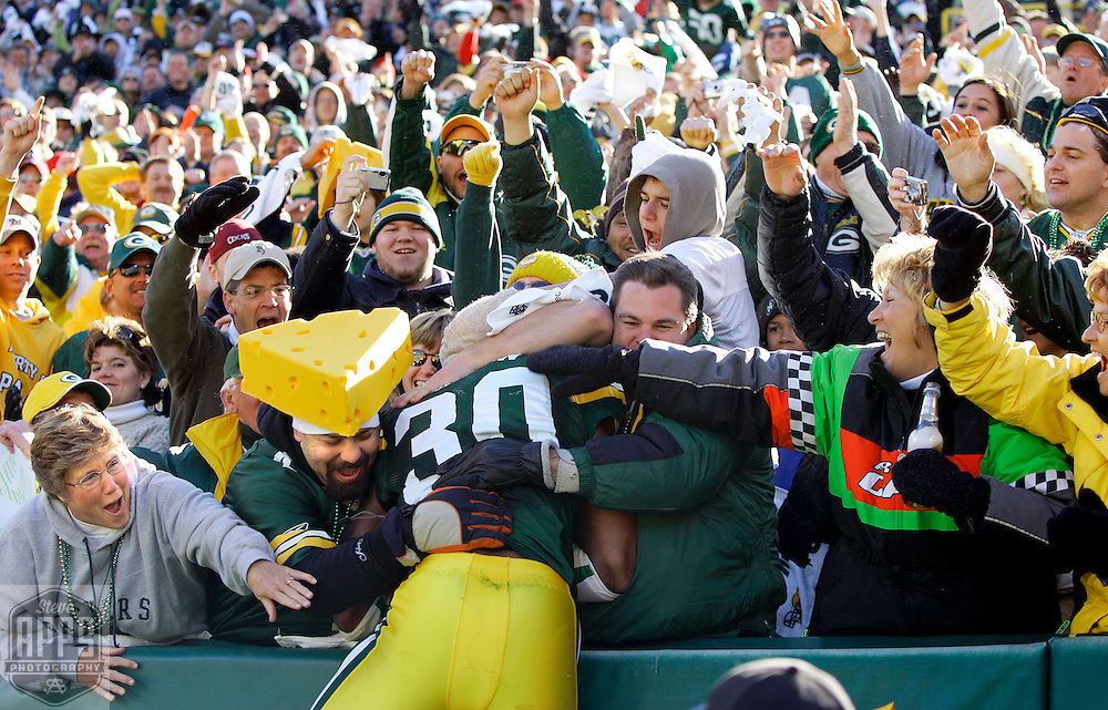 Green Bay's Ahman Green did a Lambeau Leap after scoring a 4-yard touchdown in the 2nd quarter. &amp;#xA;The Green Bay Packers hosted the Arizona Cardinals at Lambeau Field Sunday October 29, 2006. Steve Apps-State Journal.<br />