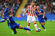 Leicester City defender Danny Simpson (17) tackles Stoke City defender Erik Pieters (3) during the Premier League match between Leicester City and Stoke City at the King Power Stadium, Leicester, England on 1 April 2017. Photo by Jon Hobley.