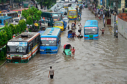 Sep 11, 2017 - Dhaka, Bangladesh - Vehicles try driving through waterlogged streets after a heavy monsoon downpour caused extreme flooding. Roads were submerged making travel slow. (Credit Image: © Mamunur Rashid via ZUMA Wire)