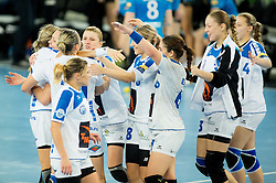 Players of Dinama-Sinara celebrate after the handball match between RK Krim Mercator (SLO) and Dinamo - Sinara (RUS) in 4th Round of Women's EHF Champions League 2014/15, on November 9, 2014 in Arena Stozice, Ljubljana, Slovenia. Photo by Vid Ponikvar / Sportida