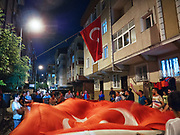 A group of young men rove the neighborhood with drums and a giant flag, dropping by Mehmet's and other conscription parties to amplify their respective celebrations.