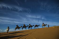 December 10, 2015 - Merzouga, Meknès-Tafilalet, Morocco - Camel caravan tourists in the Erg Chebbi sand dunes (Credit Image: © Dani Salv/VW Pics via ZUMA Wire)