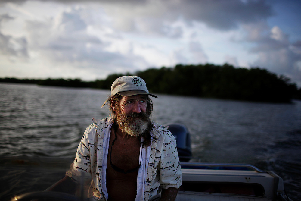 Randy Eibler, also known as Last Chance Randy, drives his skiff back to the boat he lives on anchored in Estero Bay, Fla. Eibler, 55, said he has been living on a boat since he was 21 years old, and wouldn't want to live any other way.