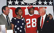 NFL Commissioner Pete Rozelle (L) poses for a photo with New England Patriots wide receiver Irving Fryar (28), Fryar's mother Allene McGhee, and New England Patriots  owner Bill Sullivan during the 1984 NFL Draft on May 1, 1984 in New York. Fryar was the first wide receiver selected with the first overall pick in an NFL draft. (©Paul Anthony Spinelli)