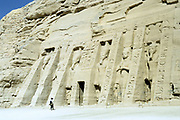 Temple of Hathor, Abu Simbel, Aswan, Egypt. Hathor was the wife of the Ancient Egyptian sun god.  Smaller than the Temple of Rameses II (1279-1213 BC)  the facade has statues of Rameses' wife Nefertari flanked by statues of Rameses.