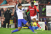 Barnsley midfielder Brad Potts (20) takes on Portsmouth defender Nathan Thompson (20) during the EFL Sky Bet League 1 match between Barnsley and Portsmouth at Oakwell, Barnsley, England on 15 December 2018.