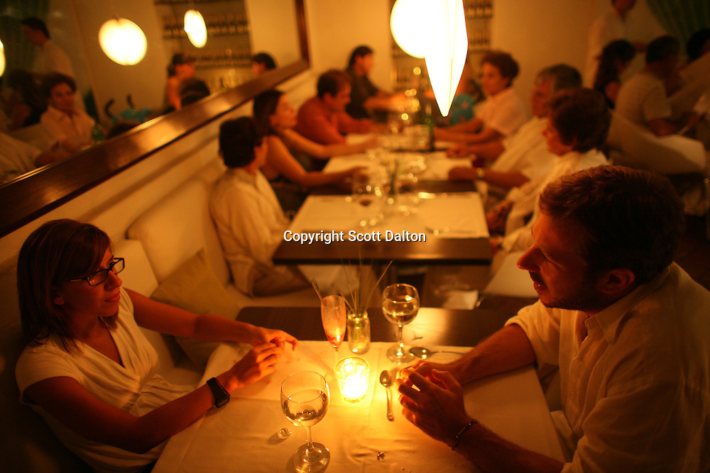 A couple waits for their meal in 8-18, a popular restaurant in Cartagena's old city, on Friday, August 22, 2008. (Photo/Scott Dalton).